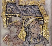 Mosaic With Two  Heads and a Building in the Background